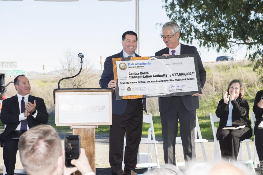 Assemblymember Grayson presents Contra Costa Transportation Authority with $77 million check for transportation funding