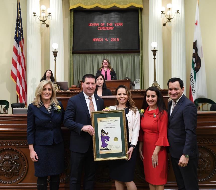 Assemblymember Grayson presents Midsi Sanchez with a Resolution on the Assembly Floor